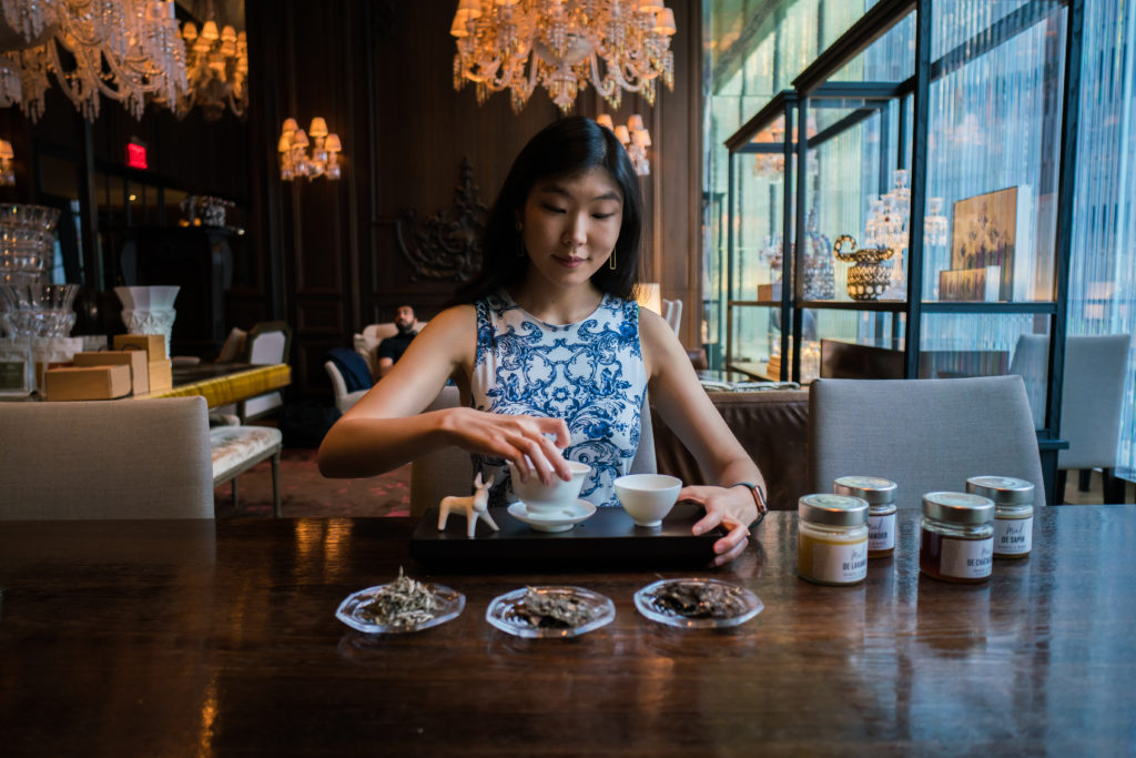 Ashley Lim, Founder of Mansa Tea, brewing aged tea with a handmade crackle gaiwan.